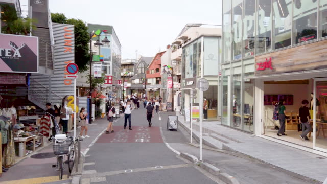 pedestrians crowded at cat street harajuku in tokyo , japan - retail place stock videos & royalty-free footage
