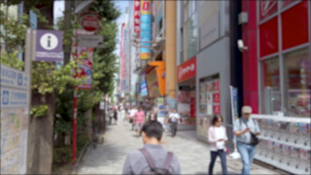 4k pedestrians crowded shopping at akihabara electric town in tokto , japan . - akihabara station stock videos and b-roll footage