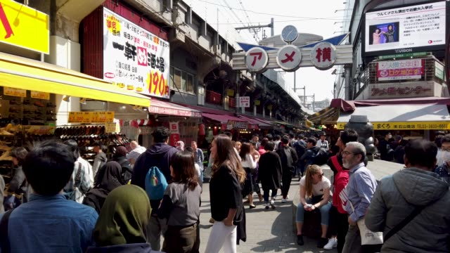 pedestrians crowded shopping at ameyoko market ueno tokyo - digital composite stock videos & royalty-free footage