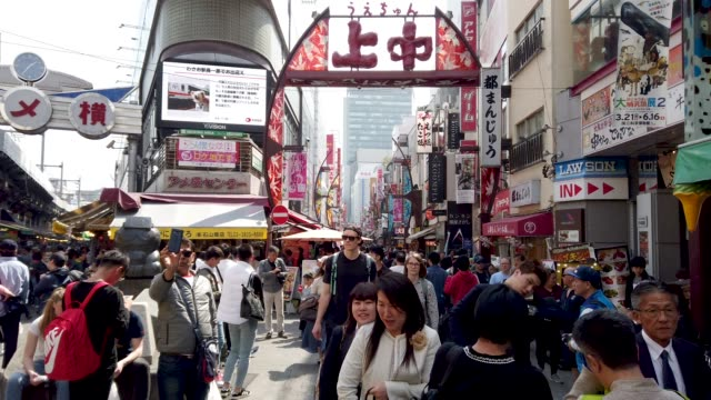 pedestrians crowded shopping at ameyoko market ueno tokyo - street market stock videos & royalty-free footage