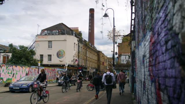 pedestrians, cyclists and traffic on brick lane, london - poster stock videos & royalty-free footage