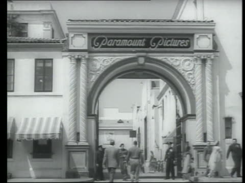 pedestrians enter and exit paramount pictures studios - paramount studios stock videos & royalty-free footage