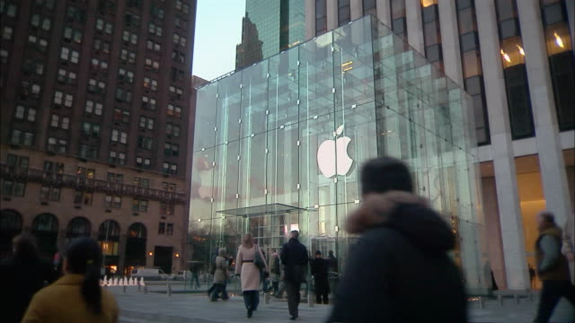 pedestrians enter the apple store on 5th avenue. - apple store stock videos & royalty-free footage