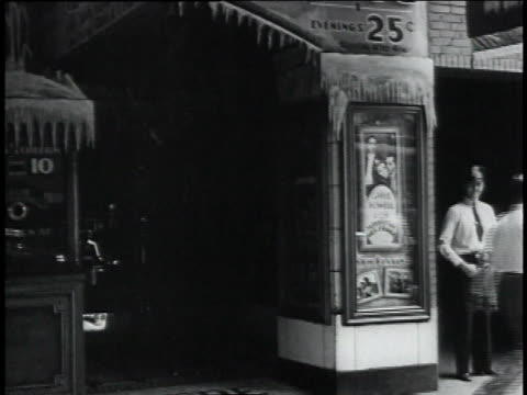 montage pedestrians exiting biograph theater box office crowd standing outside / chicago illinois united states - 1934 stock videos and b-roll footage