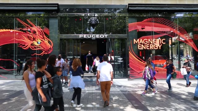 pedestrians gather outside the psa peugeot citroen automobile showroom on the avenue des champselysee in paris france on wednesday july 29 2015 shots... - bodywork stock videos & royalty-free footage