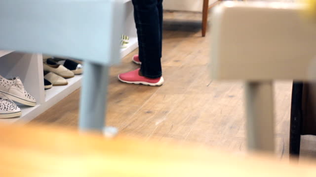 pedestrians in a shoe store. dolly shot. - dress shoe stock videos and b-roll footage