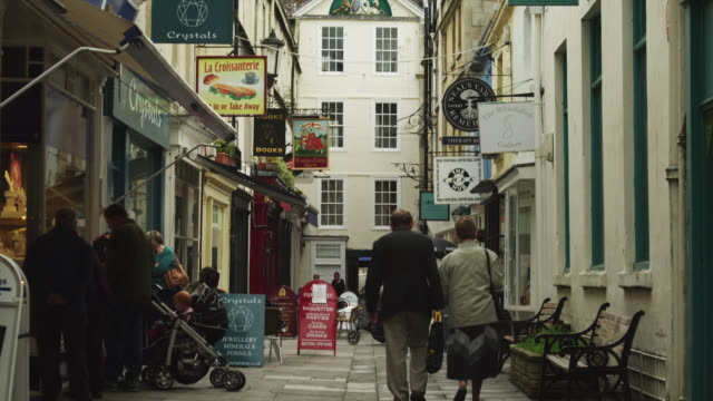 ws td pedestrians in alley / bath, somerset, uk - somerset england stock videos & royalty-free footage