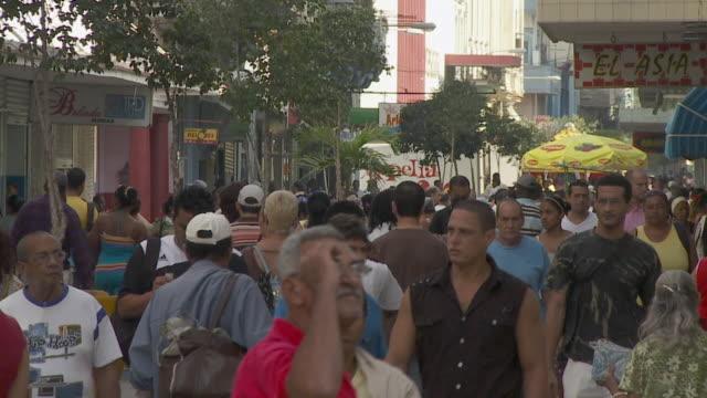 ws pedestrians in central havana / havana, cuba - kuba stock-videos und b-roll-filmmaterial