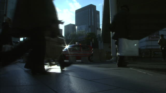 Pedestrians In Downtown Tokyo