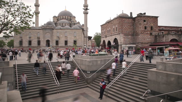 t/l ws pedestrians in eminonu district, new mosque (yeni mosque) in background / istanbul, turkey - yeni cami mosque stock videos and b-roll footage