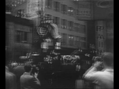pedestrians in new york city street approach running away as mounted policeman stands on sidewalk in background / montage fireman on lamppost pushes... - ethel rosenberg stock videos & royalty-free footage