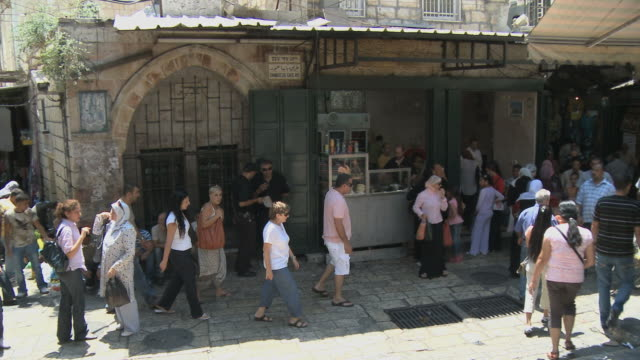 ws pan pedestrians in old town / jerusalem, israel - gerusalemme video stock e b–roll