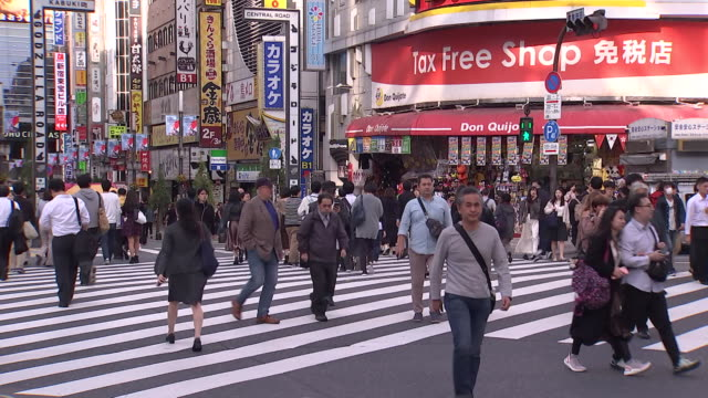 pedestrians in the shinjuku district of tokyo japan - general view stock videos & royalty-free footage