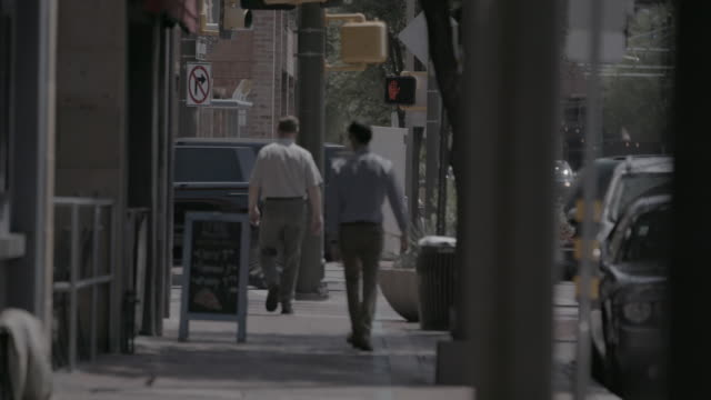 pedestrians in tucson, wide shot - obscured face stock videos & royalty-free footage