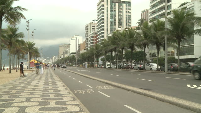 pedestrians, joggers, cyclists and traffic on avenida vieira souto, rio de janeiro, brazil [brasil] - urban road stock videos & royalty-free footage