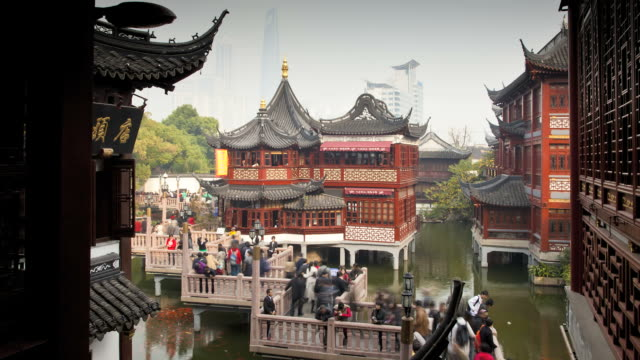 Pedestrians move along a nine-turn zig-zag bridge at Yuyuan Bazaar.