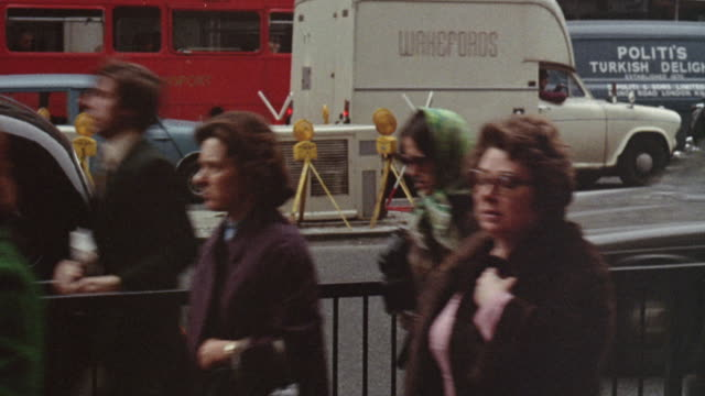 1973 montage pedestrians on a busy city street / united kingdom - 1973 stock videos and b-roll footage
