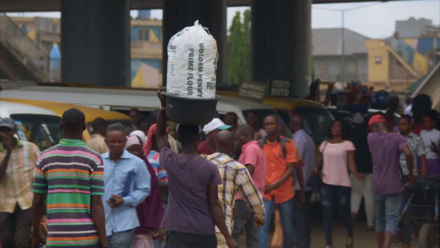 pedestrians on a busy, dusty street in lagos - nigeria stock videos and b-roll footage