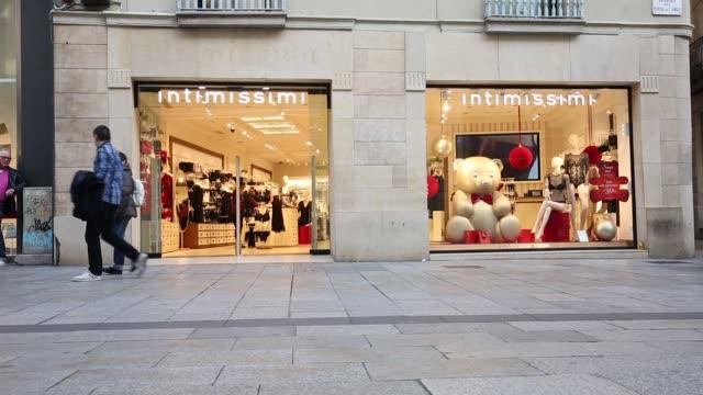 Pedestrians on a high street in Barcelona Spain on Tuesday Dec 27 Stradivarius HM Benetton Intimissimi Disney store
