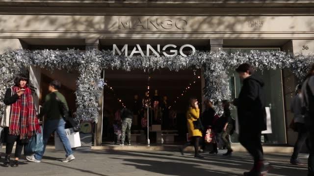 pedestrians on a high street in barcelona spain on tuesday dec 27 mango - mango stock videos & royalty-free footage