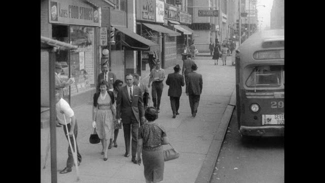pedestrians on a late 1950s new york city sidewalk - polio stock videos & royalty-free footage