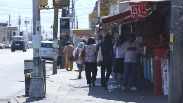 pedestrians on brooklyn street, wide shot - pedestrian stock videos & royalty-free footage