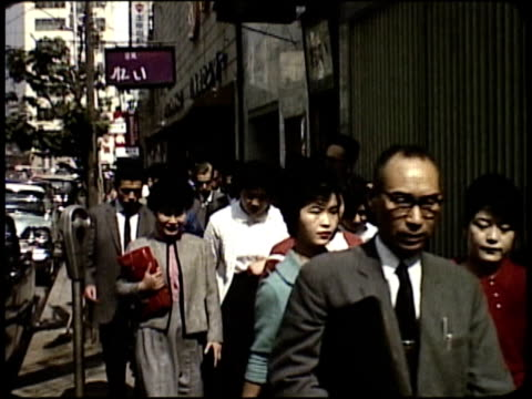 vídeos de stock e filmes b-roll de 1963 montage pedestrians on busy business district streets / japan  - 1963