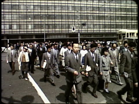 stockvideo's en b-roll-footage met 1963 montage pedestrians on busy business district streets / japan  - 1963