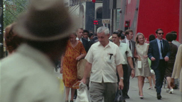 1969 ms pedestrians on busy manhattan sidewalk / new york city, new york - anno 1969 video stock e b–roll