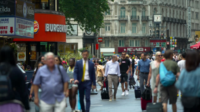 pedestrians on leicester square in london - luggage stock videos & royalty-free footage