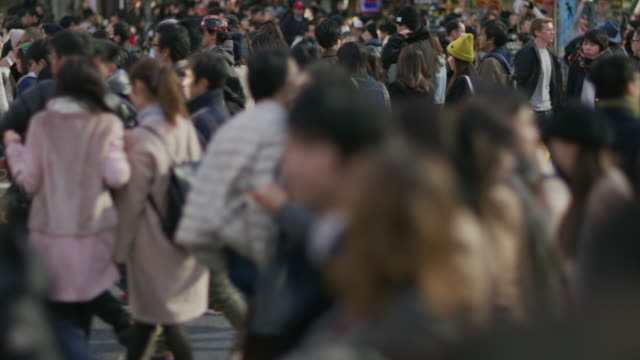 SLO MO, LS Pedestrians on Shibuya scramblewalk / Tokyo, Japan