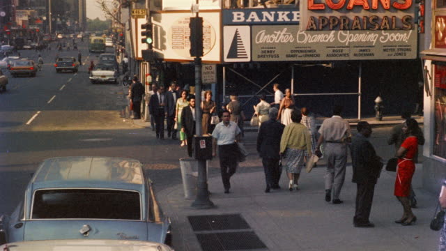 1958 ws tu pedestrians on sidewalk and store signs in 46th st., new york city, new york, usa - anno 1958 video stock e b–roll