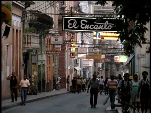 ms, pedestrians on street, santiago de cuba, cuba  - western script stock videos & royalty-free footage