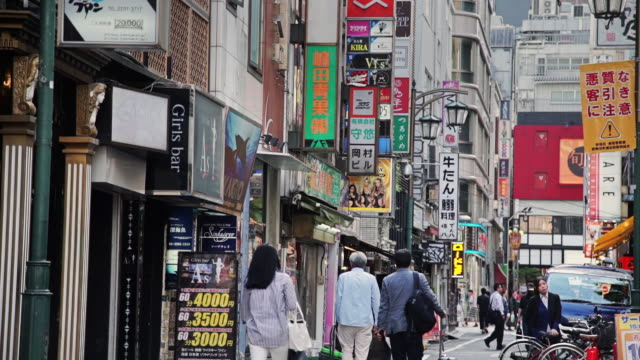 pedestrians on tokyo shopping street - retail place stock videos and b-roll footage
