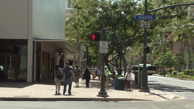 ws pedestrians on waikiki shopping street / honolulu, hawaii, usa - honolulu stock videos and b-roll footage