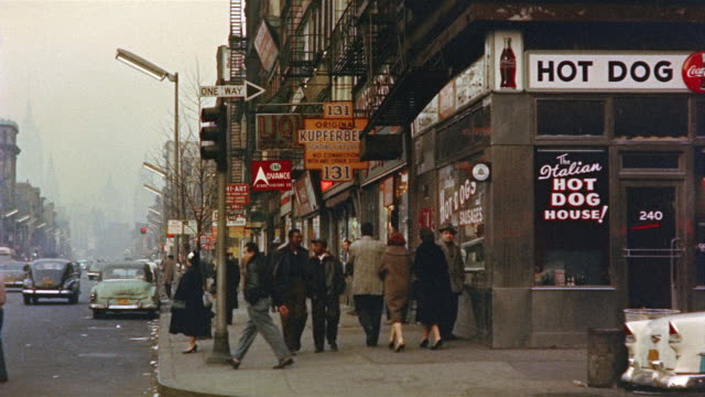 vídeos de stock e filmes b-roll de 1959 ws pedestrians outside stores in bowery area of lower east side manhattan/ new york, usa - 1950 1959