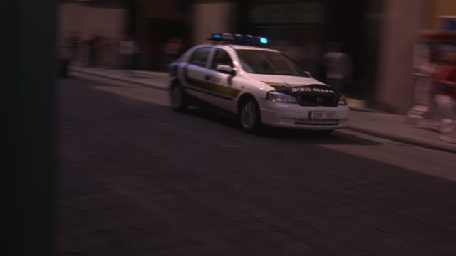 pedestrians panicking as a police car chases another car through heavy traffic. - terrified stock videos & royalty-free footage