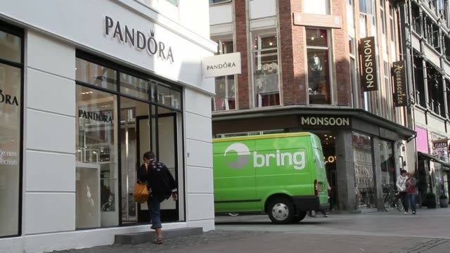 pedestrians pass a closed pandora a/s jewelry store at night in copenhagen, denmark, on thursday, sept. 12 pedestrians pass a pandora store in the... - oresund region stock videos & royalty-free footage