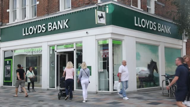 Pedestrians pass a Lloyds bank branch a unit of Lloyds Banking Group Plc in London UK on Friday Aug 4 2017