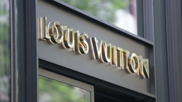 Pedestrians Pass A Louis Vuitton Sa Luxury Store In Frankfurt