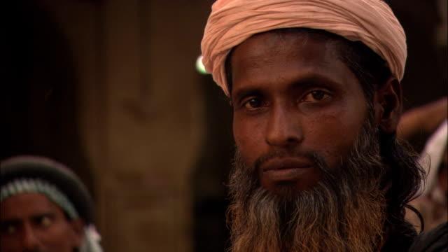 pedestrians pass a man wearing a turban. - turban stock videos & royalty-free footage