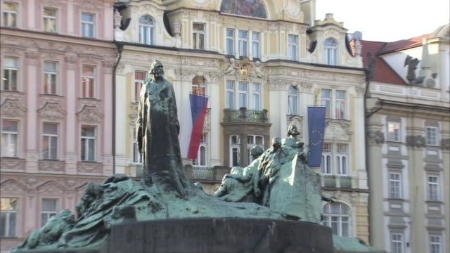 pedestrians pass a memorial in a prague town square. - czech republic stock videos & royalty-free footage