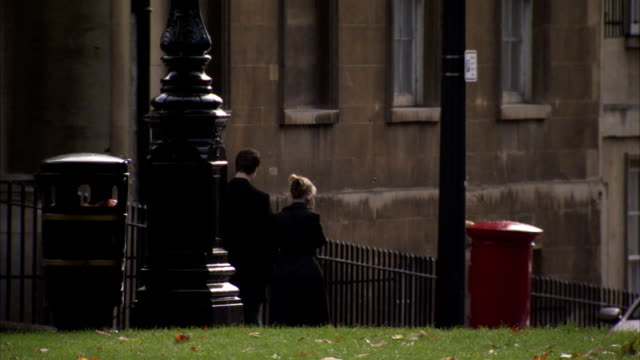 pedestrians pass a postbox in queen square in bath. available in hd. - mailbox stock videos and b-roll footage