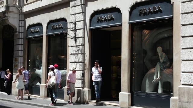 Pedestrians pass a Prada SpA store as they walk along Via Condotti in Rome Pedestrians pass a Prada SpA store as they walk along Via Condotti near...