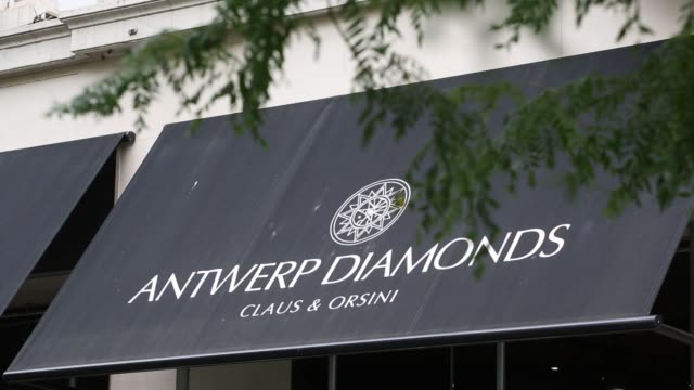 pedestrians pass a row of luxury stores selling diamonds in the diamond district of antwerp belgium on thursday july 20 2017 - stadtviertel stock-videos und b-roll-filmmaterial