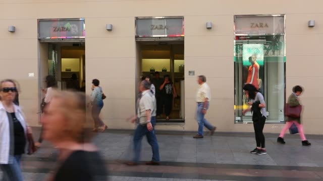 Pedestrians pass a Zara fashion store on Preciados Street in Madrid on Thursday May 8 Pedestrians walk along a shopping street in Madrid Pedestrians...