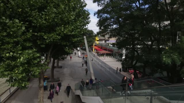 pedestrians pass along the south bank of the river thames in london uk on wednesday sept 18 pedestrians walk past royal festival hall in london the... - royal festival hall stock videos and b-roll footage