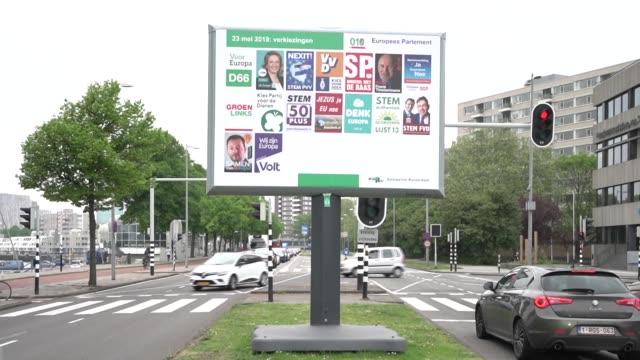 pedestrians pass an election campaign billboard poster featuring dutch political parties stands ahead of european parliament elections in amsterdam... - gewerbliches schild stock-videos und b-roll-filmmaterial