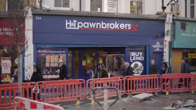 pedestrians pass an h and t pawnbrokers in walthamstow on friday november 21 jewelry sits on display in the window - pawnbroker stock videos & royalty-free footage