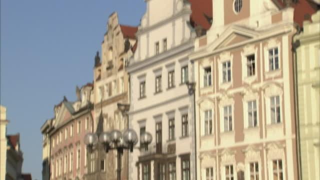pedestrians pass an outdoor cafe in prague. - czech republic stock videos & royalty-free footage